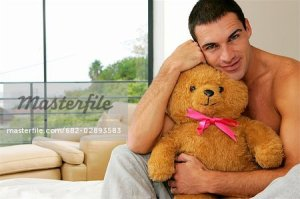 682-02893583 © Masterfile Royalty Free Model Release: Yes Property Release: No Shirtless Man Holding a Teddy Bear